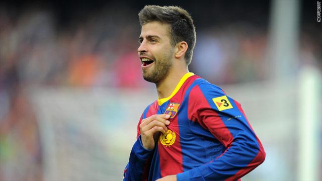 Barcelona defender Gerard Pique celebrates his goal in the Nou Camp against Espanyol.