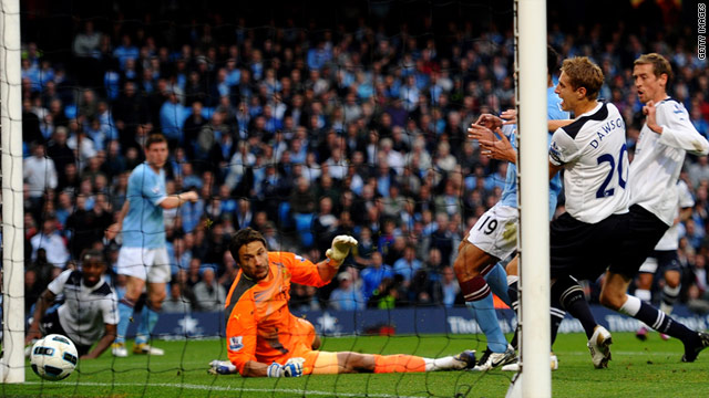 Peter Crouch (far right) scores the own goal that ensured Manchester City qualified for the Champions League.
