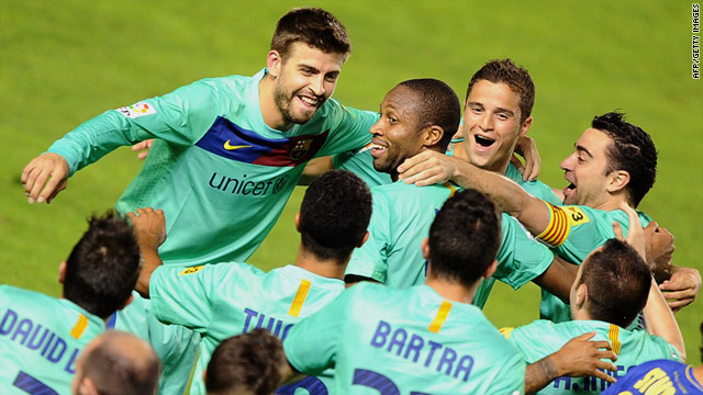 Barcelona's players celebrate after winning the 21st La Liga championship in the Catalan club's 111-year history.