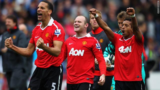 Captain Rio Ferdinand, left, goalscorer Wayne Rooney, center, and Nani celebrate Manchester United's title triumph.