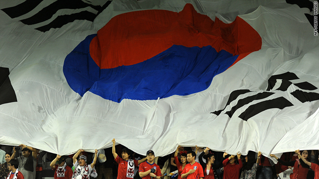 South Korean football fans cheer for their team during the 2011 Asian Cup football match on January 28 in Doha, Qatar.