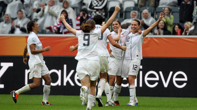 The U.S. women celebrate Alex Morgan's goal in the 3-1 win over France.
