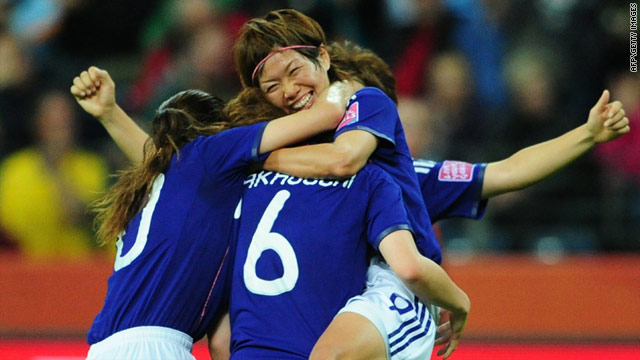 Midfielder Nahomi Kawasumi (R) celebrates Japan's 3-1 victory vs Sweden during the women's World Cup semifinal, on July 13.