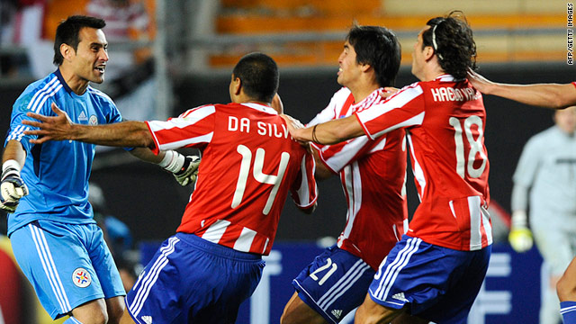 Paraguayan players celebrate their quarter-final victory over Brazil at the Ciudad de La Plata stadium in La Plata, Argentina.
