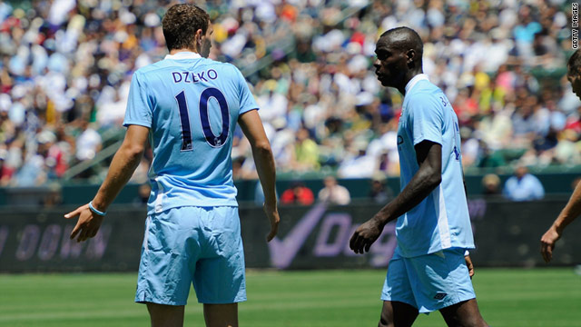 Edin Dzeko (left) reacts angrily after Mario Balotelli (right) wastes a good opportunity in City's match with Los Angeles Galaxy.