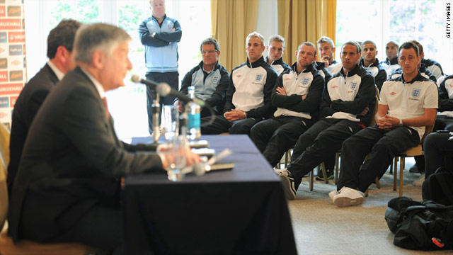 England's players listen as the English Football Association's chairman David Bernstein cancels the game with Holland.