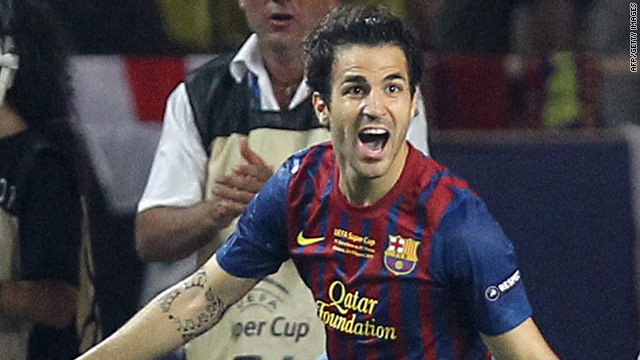 Cesc Fabregas celebrates his first Barcelona goal as the European champions beat Porto to lift the Super Cup.