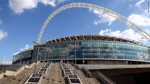 Police have arrested six men after a man died outside Wembley Stadium on Tuesday before a Euro 2012 qualifying match.