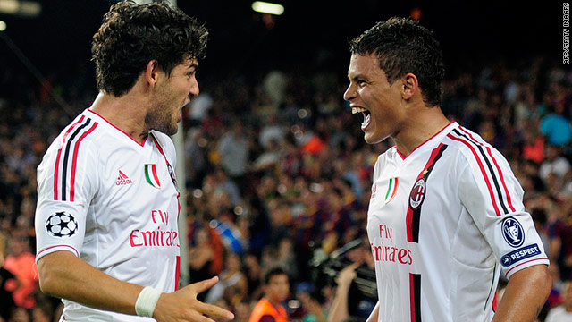 Thiago Silva and Pato celebrate AC Milan's last-gasp equalizer against Barcelona.