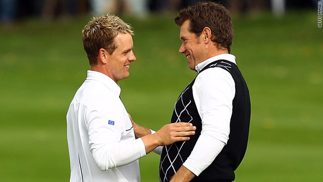 Lee Westwood (R) leapt to the top of the golf world rankings on Sunday, at the expense of Ryder Cup teammate Luke Donald.