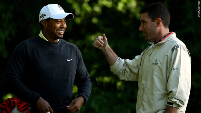 Tiger Woods, left, with his manager Mark Steinberg during during the pro-am for the Quail Hollow Championship in 2010.