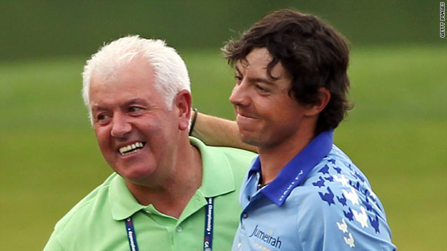 After winning the U.S. Open on Father's Day, 22-year-old Rory McIlroy celebrates with his dad.