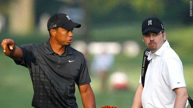 Tiger Woods with friend Bryon Bell, who will caddie for him at this week's Bridgestone Invitational tournament in Ohio.