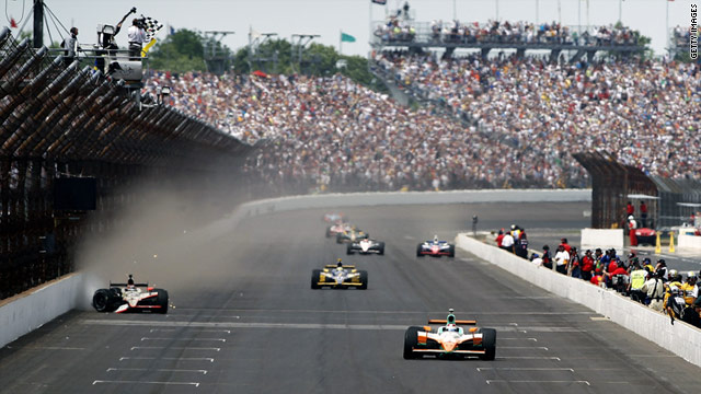 Dan Weldon, right, takes the checkered flag to win the Indianapolis 500, which marked its 100th anniversary.