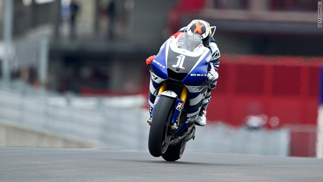 World champion Jorge Lorenzo closed the gap on Casey Stoner in the title standings after victory in Italy.