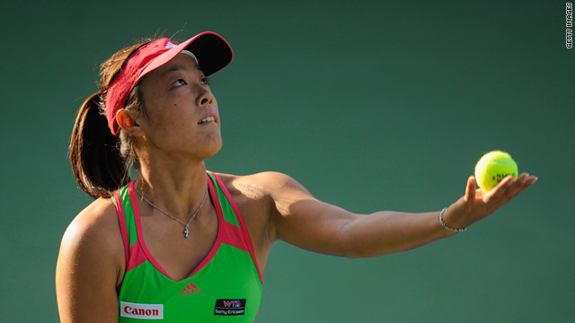 Ayumi Morita of Japan serves on the way to her straight sets win over Petra Kvitova in Dubai.