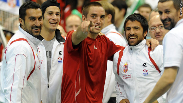 Viktor Troicki, center, celebrates with his teammates after securing victory for Serbia in the first round of the Davis Cup.