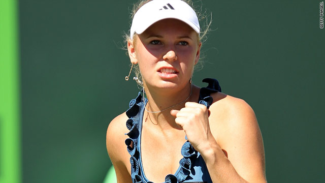 The world No. 1 celebrates victory in her first match of the Miami Open tennis tournament.