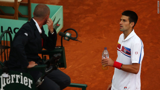 Novak Djokovic talks to the umpire shortly before his match against Juan Martin del Potro was suspended.