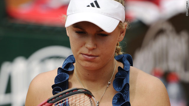 Caroline Wozniacki's misery in Grand Slam's continued as she was knocked out of the French Open by Daniela Hantuchova.