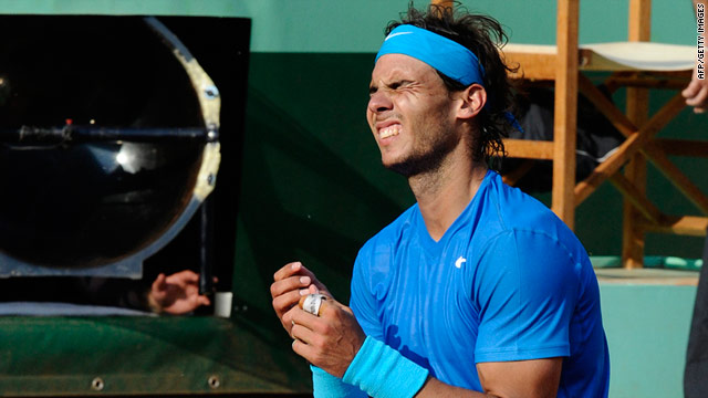 Rafael Nadal celebrates securing his sixth French Open title after a four-set victory over old rival Roger Federer.