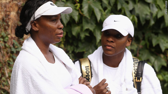 Venus Williams, left, and younger sister Serena relax after a training session at Wimbledon on Saturday.