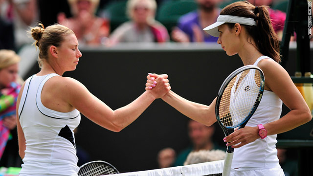 A disappointed Vera Zvonareva, left, shakes hands with Tsvetana Pironkova after losing to the Bulgarian 32nd seed.