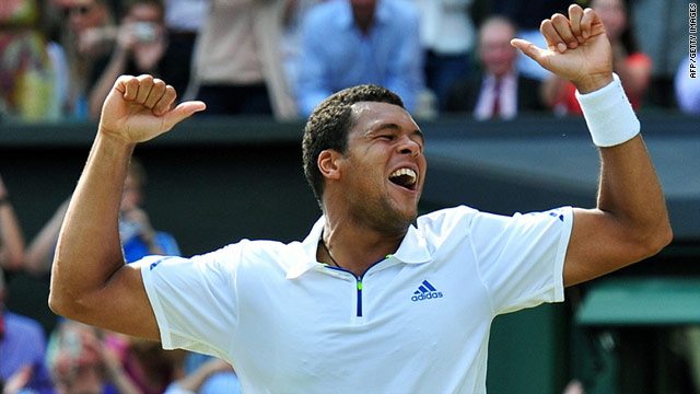 French tennis player Jo-Wilfried Tsonga dances with joy after beating Roger Federer on Centre Court at Wimbledon.