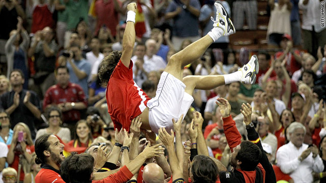 David Ferrer is lifted above his teammate's shoulders after his win over Mardy Fish on Sunday.