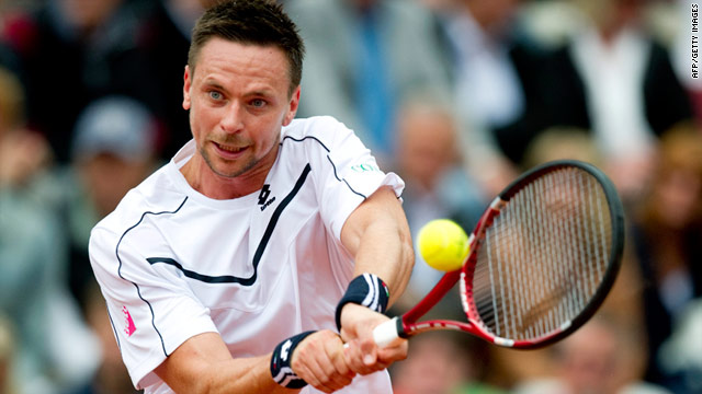 Robin Soderling defeated David Ferrer to bounce back from last year's final defeat by Nicolas Almagro.