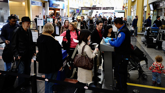 Travelers go through a security checkpoint at Reagan National Airport in Arlington, Virginia.