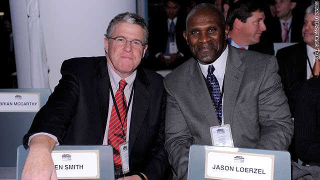 Sportswriter Peter King, left, and Pro Football Hall of Famer Harry Carson attend a Sports Illustrated party in New York.