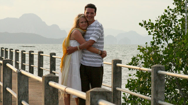 Natalie and David McCraigh relax in Thailand. For a while, they kept quiet about being American while traveling.