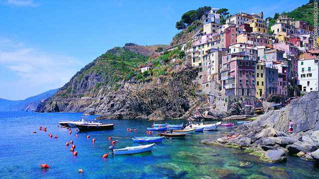Many of you guessed correctly. The port pictured is the Italian Riviera town of Cinque Terre.
