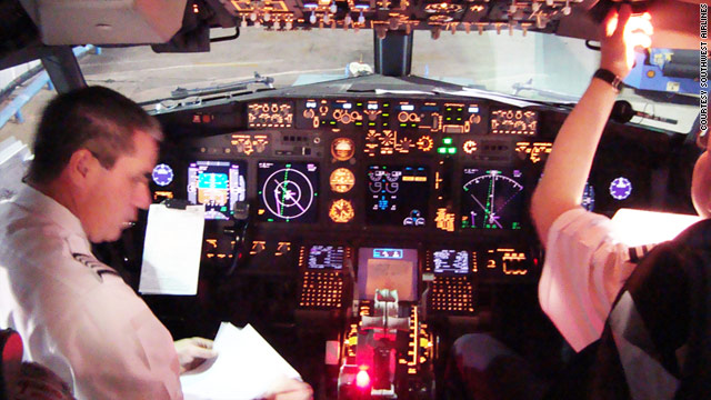 Captains Jeff Martin, left, and Kevin Fergerson work with GPS-based traffic displays in a Southwest Airlines cockpit.