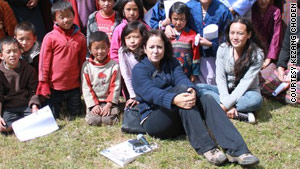 Lisa Napoli, surrounded by children in the village of Ura, has now visited Bhutan six times.