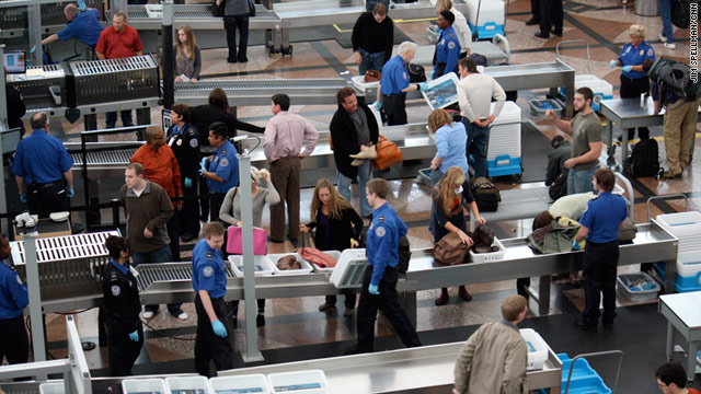 Travelers at Denver International Airport line up at a Transportation Security Administraton checkpoint.