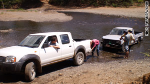 CNN's Nick Parker tugs a stranded pickup out of the water.