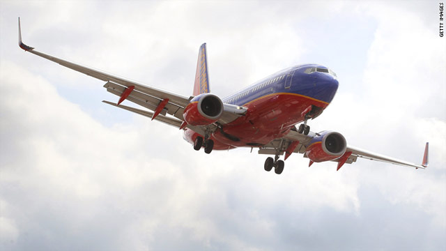 A Southwest Airlines passenger jet prepares to land at Midway Airport in Chicago on Tuesday.