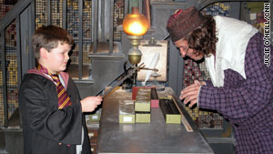 Barrett Brazelton, 8, looks for his perfect wand match in Ollivanders wand shop.