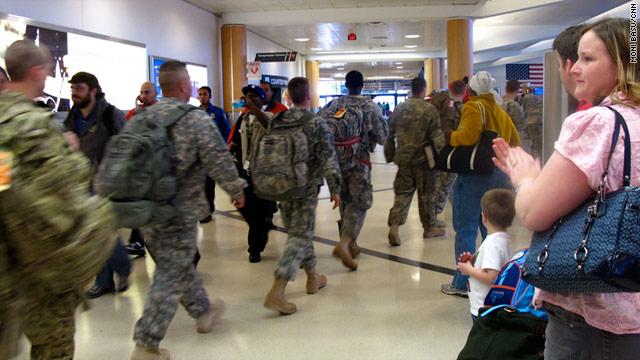Travelers clap for service members at Atlanta's Hartsfield-Jackson International Airport.
