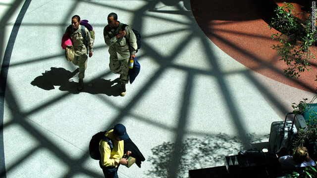 Service members make their way through the atrium at Atlanta's Hartsfield-Jackson International Airport.