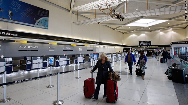 A traveler walks to security at Charlotte Douglas International Airport.