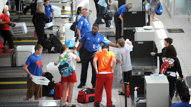 Air travelers pass through security at Orlando International Airport in Florida on Monday.