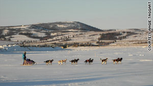 Taggart and her team of dogs move across the ice just after leaving the checkpoint of Unalakleet.