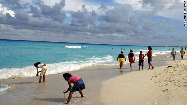 Beach resorts on the Yucatan Peninsula are removed from the violence, author says.