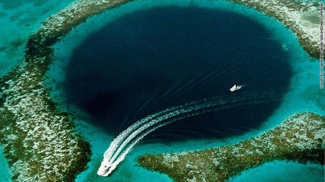 The Belize Barrier Reef is home to whale sharks, rays and manatees. One of its most famous sites is the Great Blue Hole.