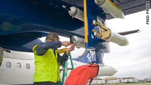 An engineer makes final checks on a BAe 146 aircraft fitted with the AVOID system for 'ground testing.'