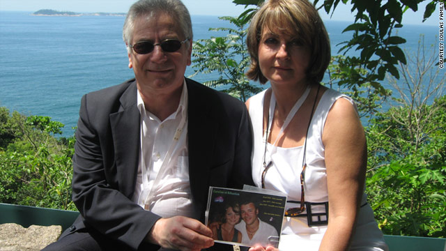 Robert Soulas and his wife, Corinne, hold a photo of their daughter and son-in-law who died aboard Air France Flight 447.