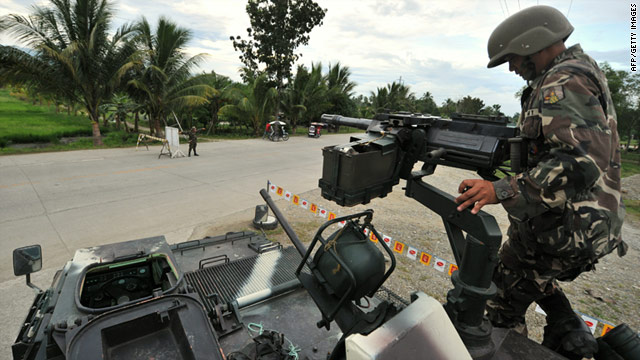 A Filipino soldier mans a checkpoint in 2010 on the island of Mindanao. The U.S. says the island is at risk of harboring terrorists.